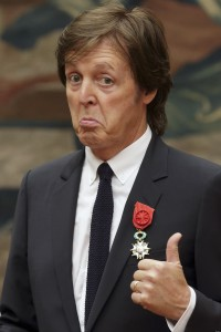 Paul McCartney poses during a decoration ceremony at the Elysee Palace in Paris